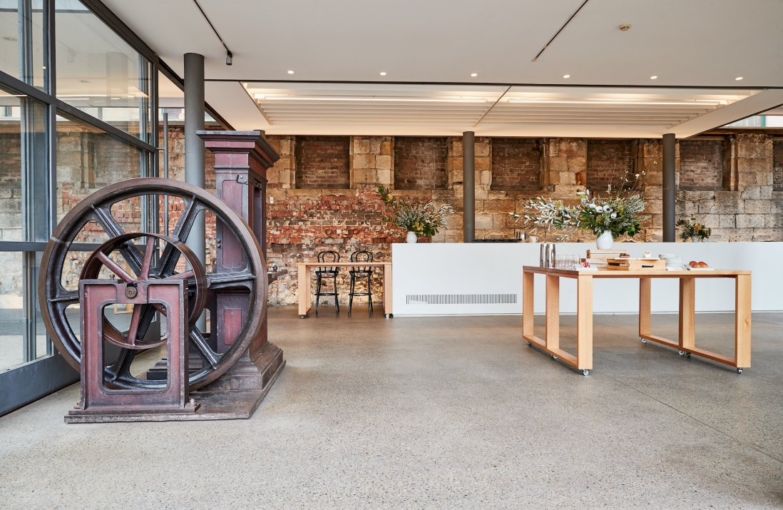Open plan bar area with old machinery display in one corner.