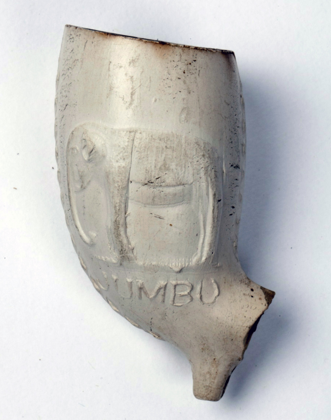 White clay pipe bowl with stem cut off, and carving of elephant.