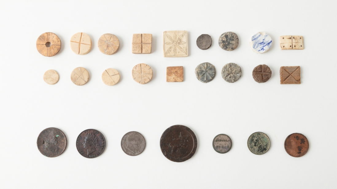 Various gaming tokens and coins found underfloor and underground at Hyde Park Barracks during excavations