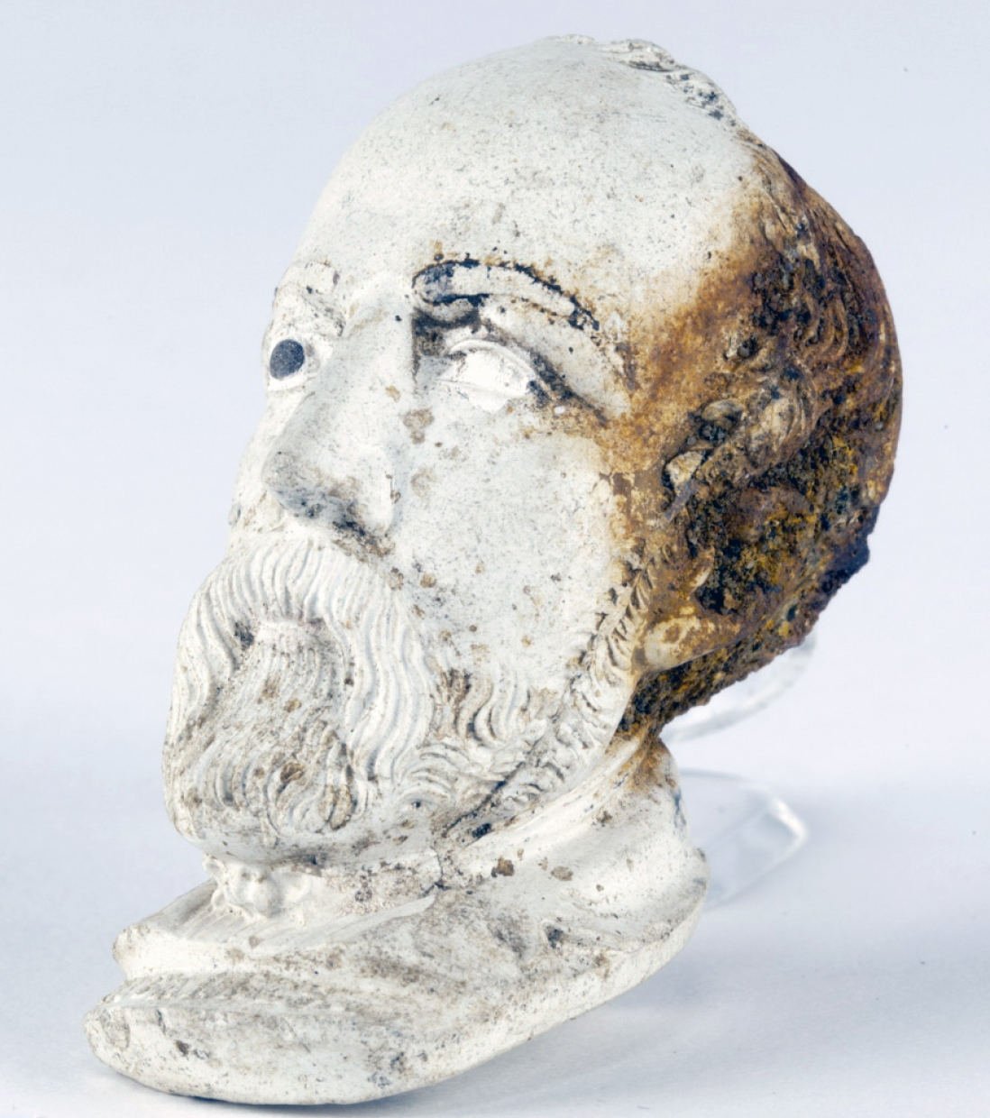 White modelled head of man, discoloured brown at back.