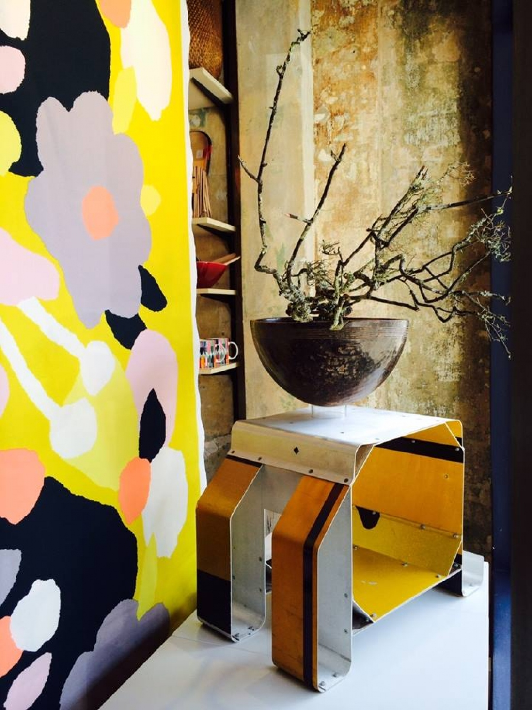 Vintage African wooden bowl on metal 'Sign Stool' by Trent Jansen with Marimekko printed cotton backdrop.