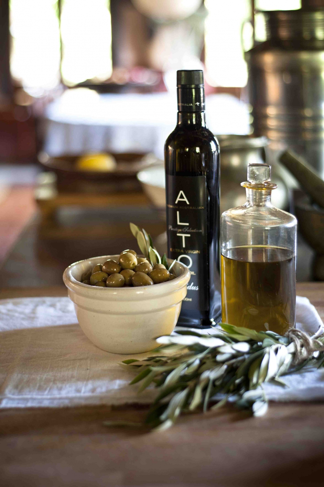 Bottles of olive oil and dish of olives
