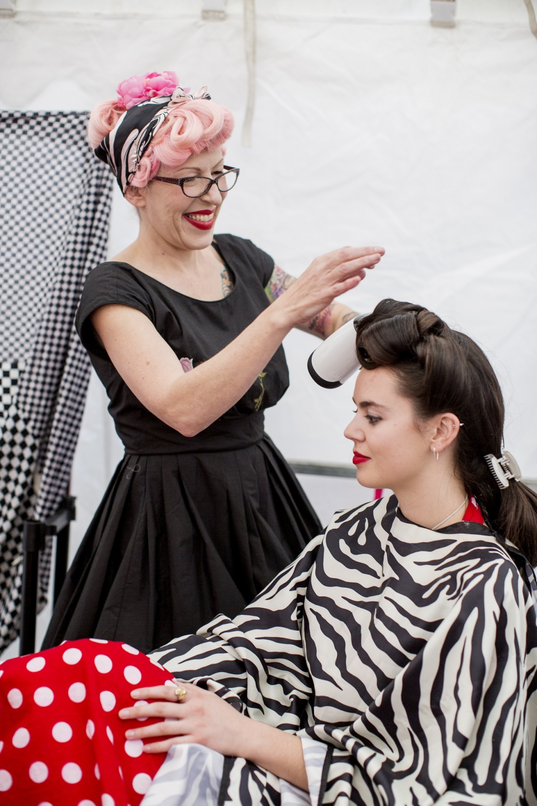 Photo of woman cutting another woman's hair