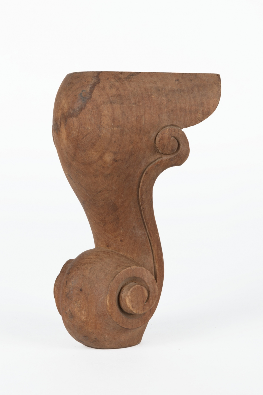 A carved timber furniture leg