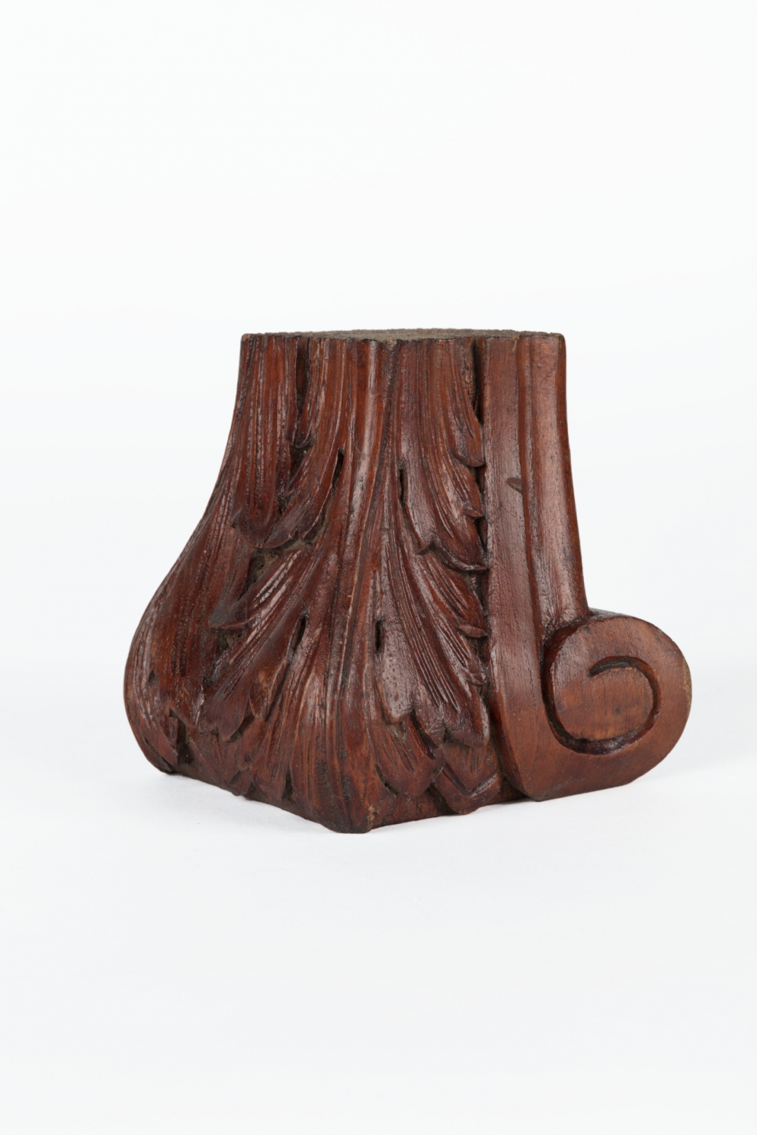 A carved timber furniture foot