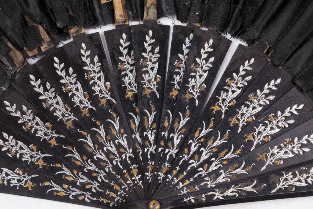 Detail of a black silk taffeta concertini fan, showing the painted sticks. India and China, 1870-1890.