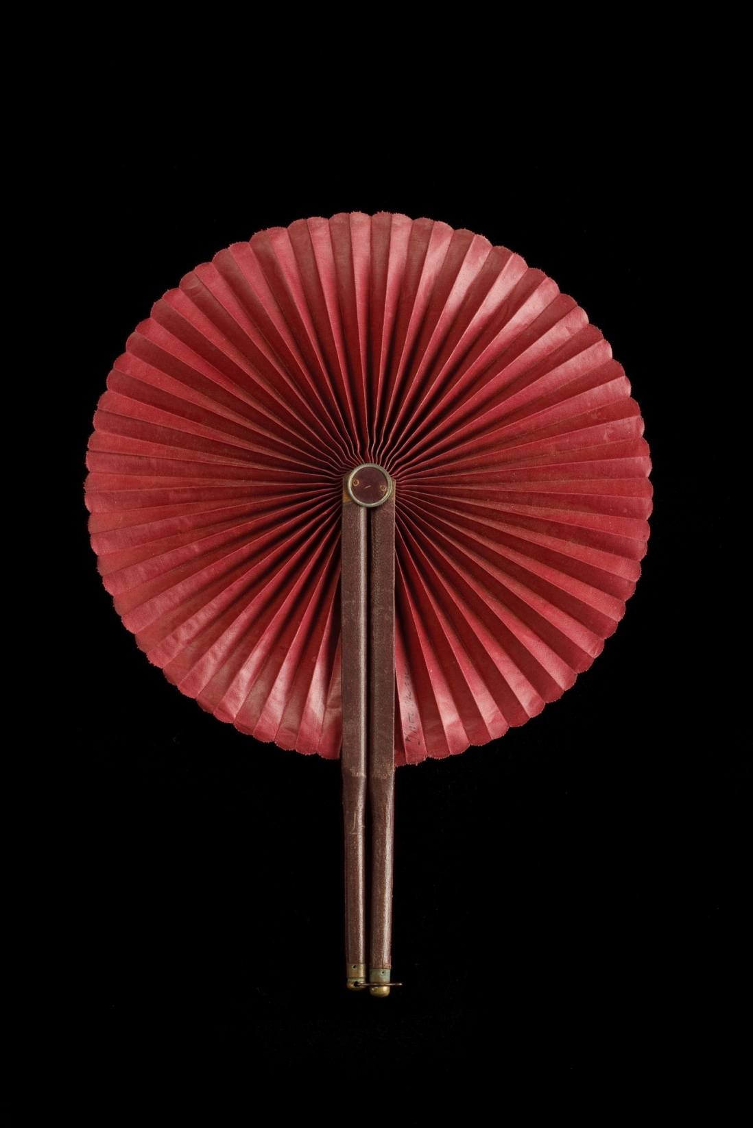 Cockade fan. Wood with leatherette and fabric. Likely Chinese, early 1900s.