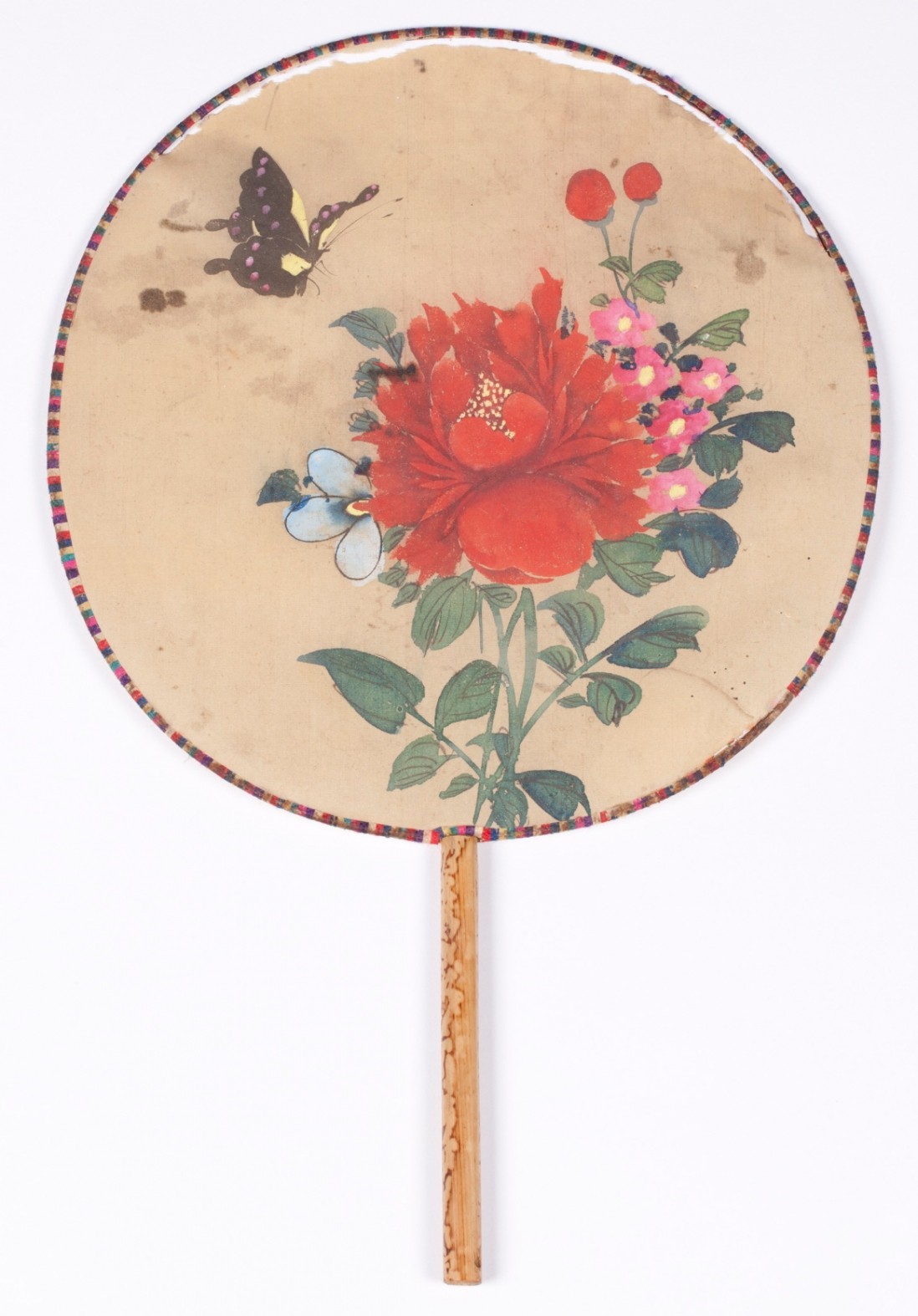 Fixed blade fan of painted silk and bamboo. Likely Japanese, and pre-1939.
