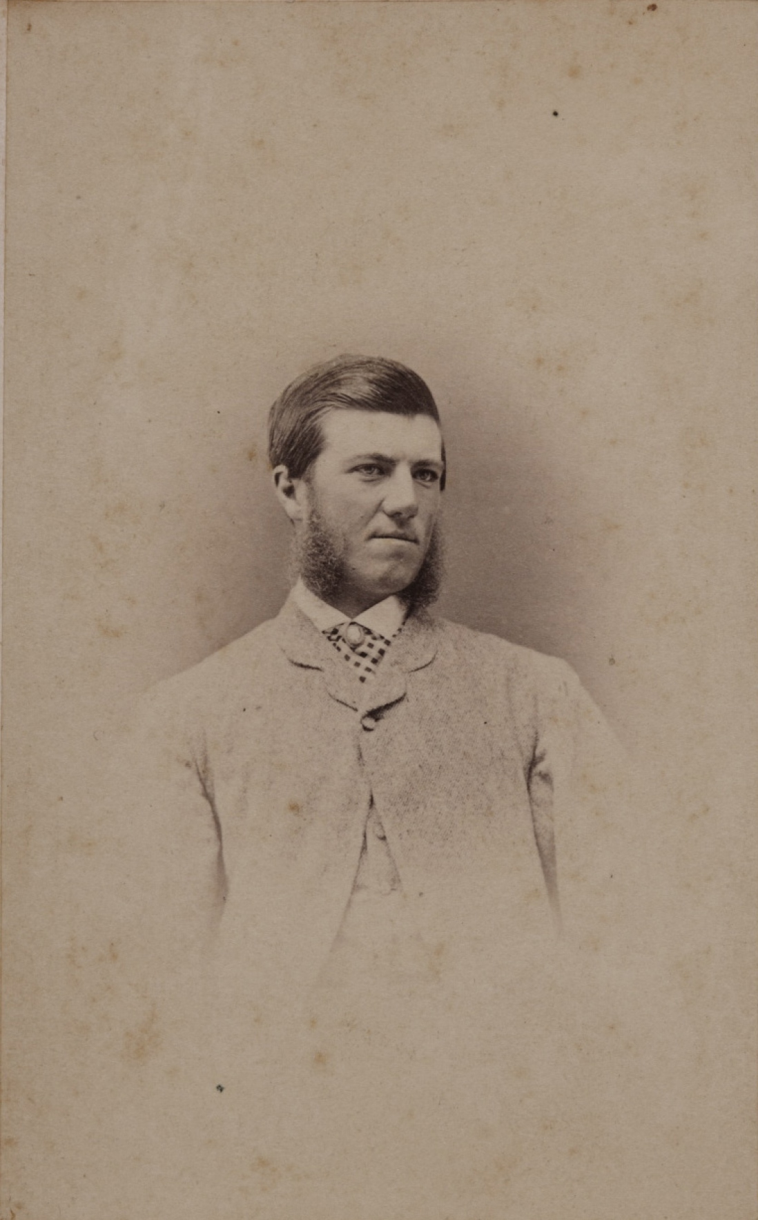 Black and white portrait of man with mutton chop whiskers.