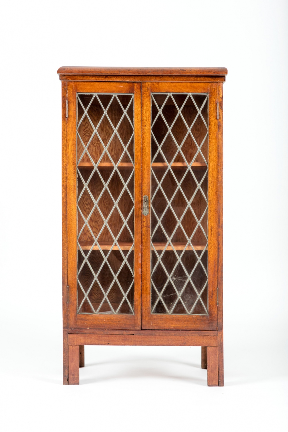 Timber cabinet with diamond shaped patterned glass front.