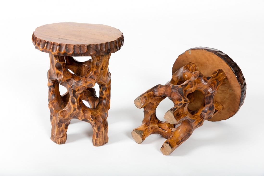 Pair of carved round topped tables with rustic timber legs.
