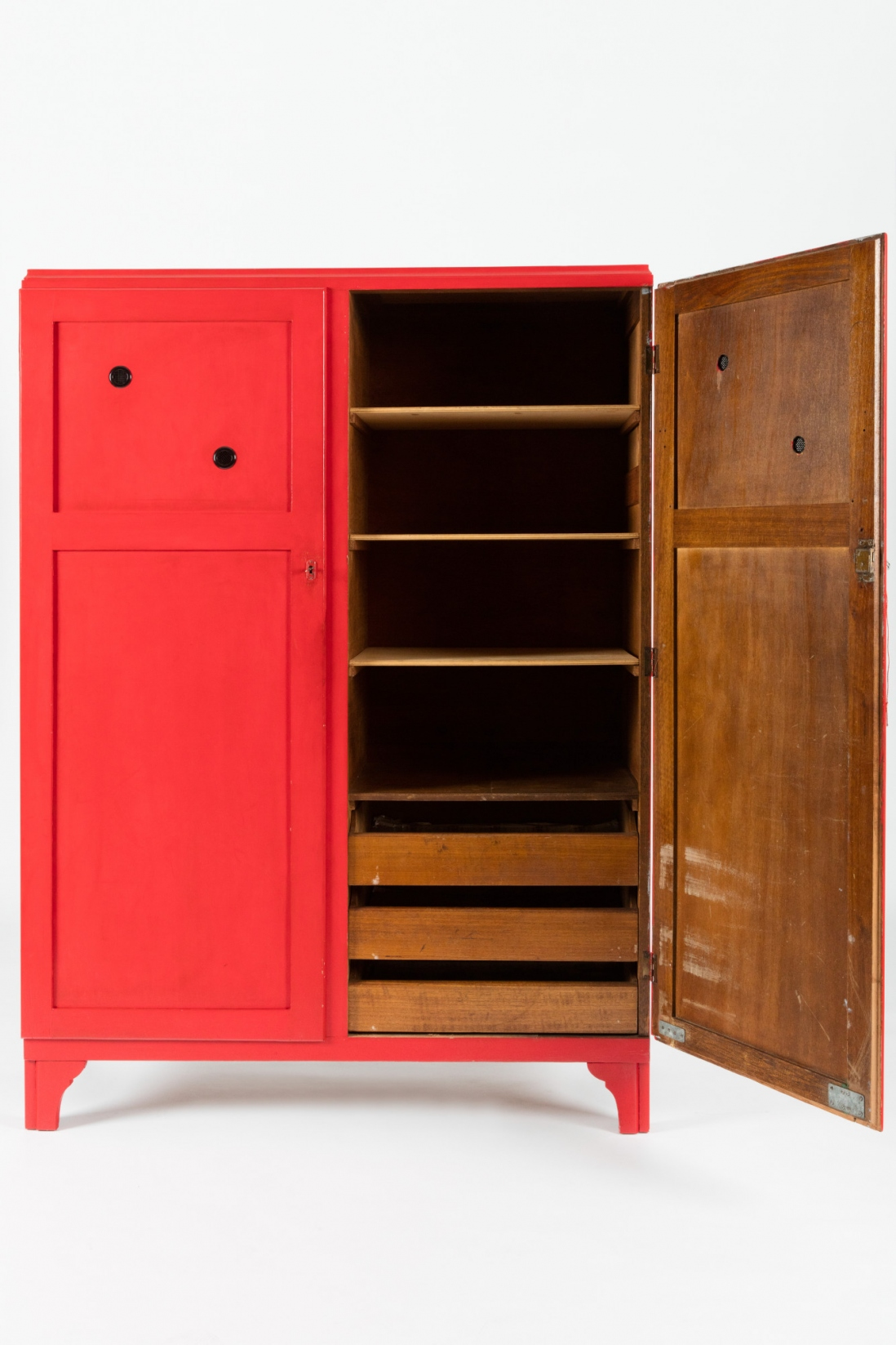 Red timber cupboard with right hand door open to show shelving.