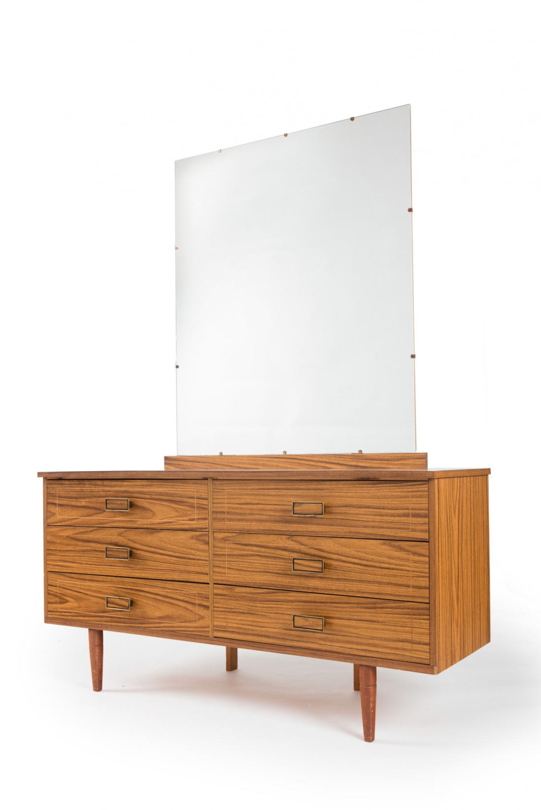 Timber chest of drawers with mirror attached above.