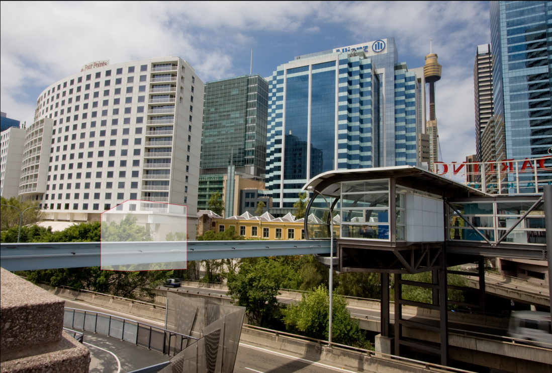 View of cityscape including monorail and high rise buildings.