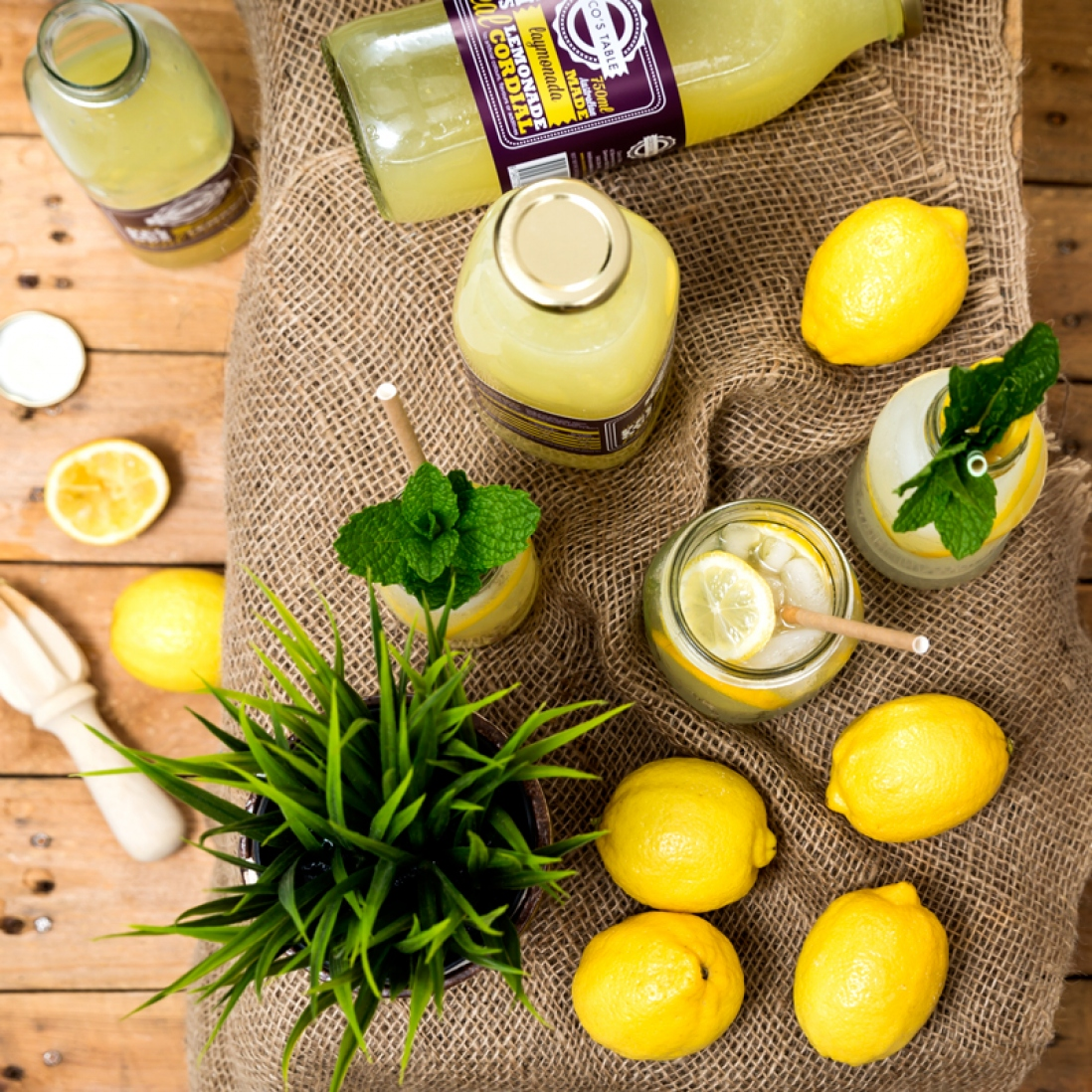 Image of lemons and herbs and bottled produce