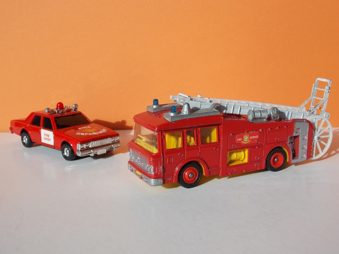 Toy fire chief's car and fire truck