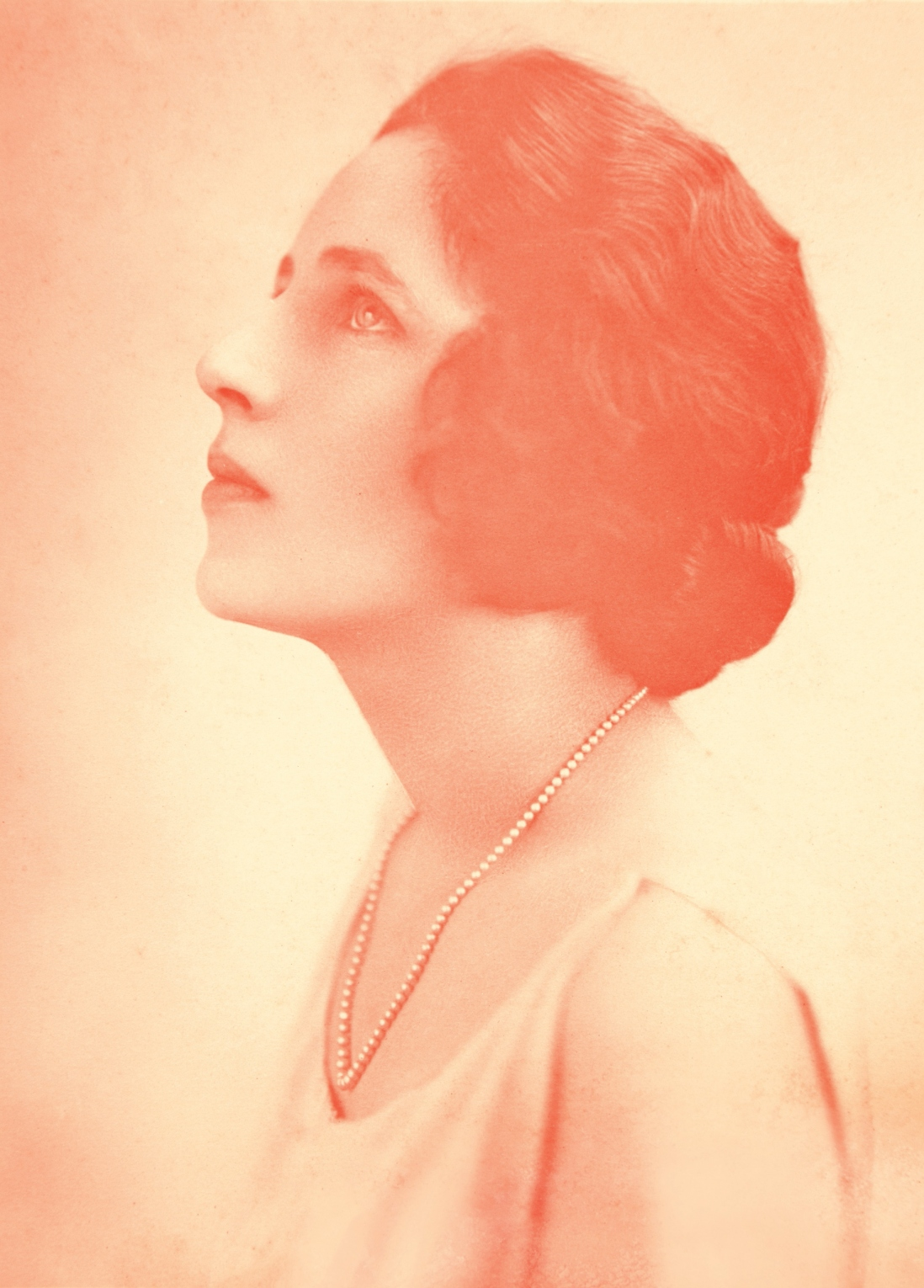 Orange tinted sepia image of woman looking up to left.