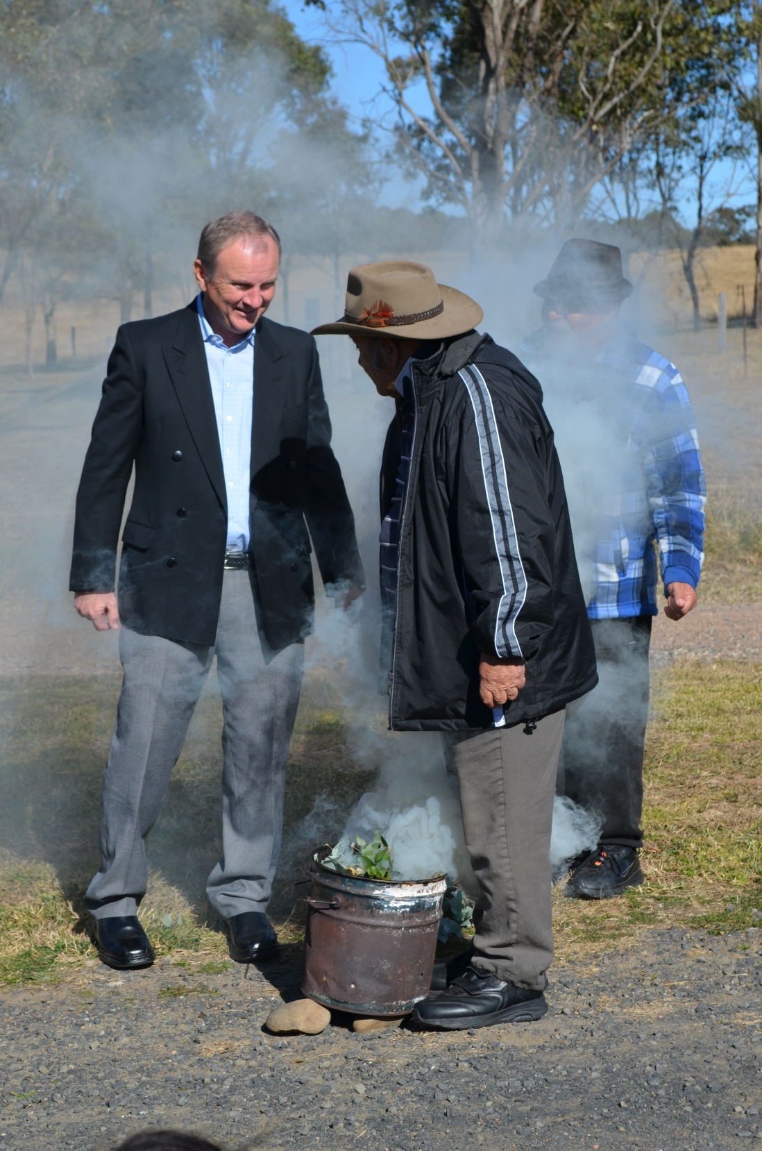Local member Kevin Conolly with local Darug leaders during smoking ceremony