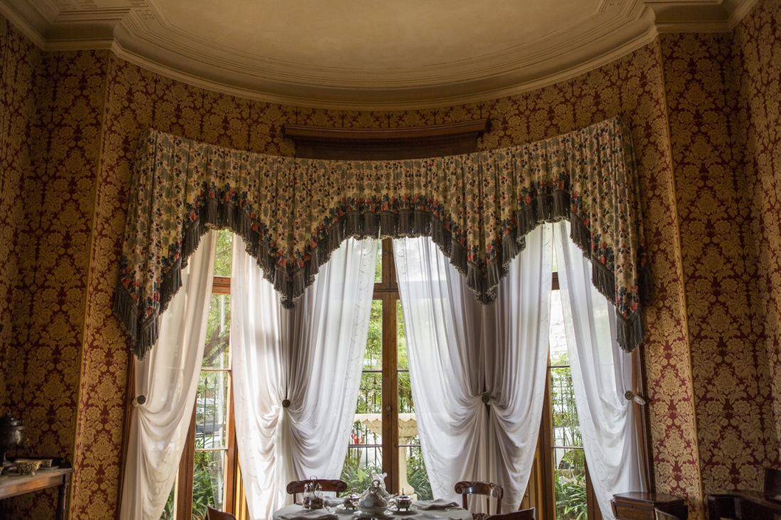 View of the curtains and french doors in the breakfast room.