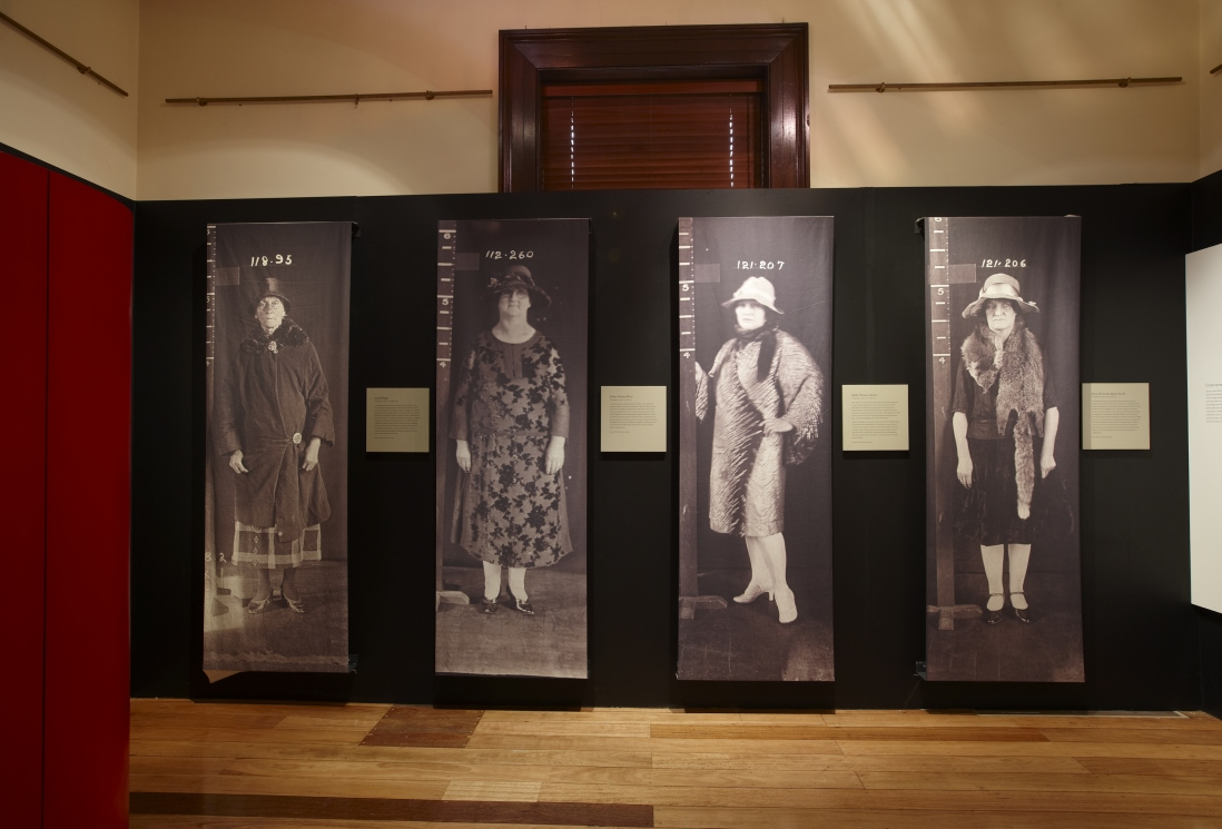 Image showing for life size black and white prints of woman standing