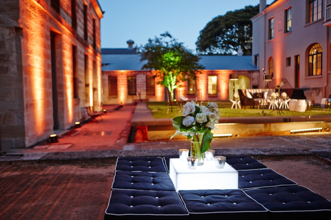 Courtyard lit with coloured lighting.