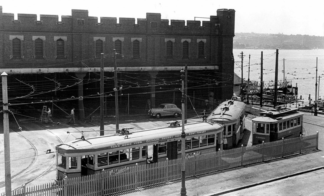 B&W image of a tram in front of the tram shed at Bennelong Point