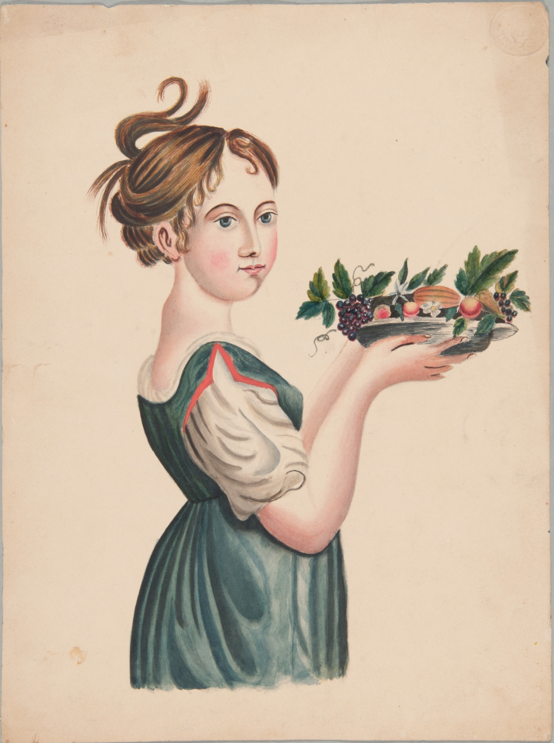 A girl holding a plate of fruit