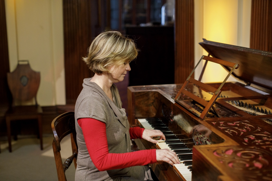 Sandra France, pianist and composer, playing piano in the saloon at Elizabeth Bay House