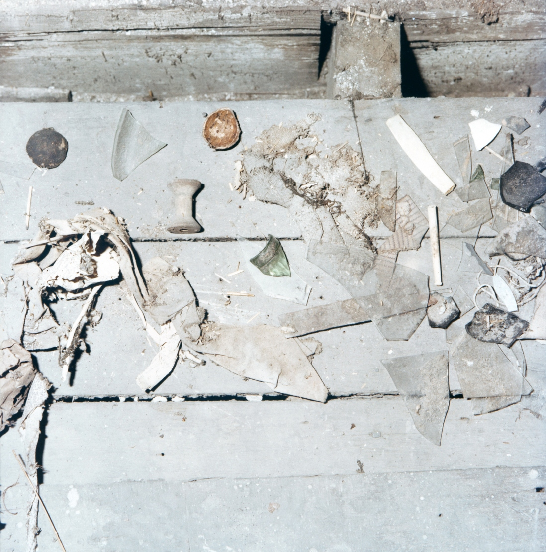 Collection of items on floorboards.