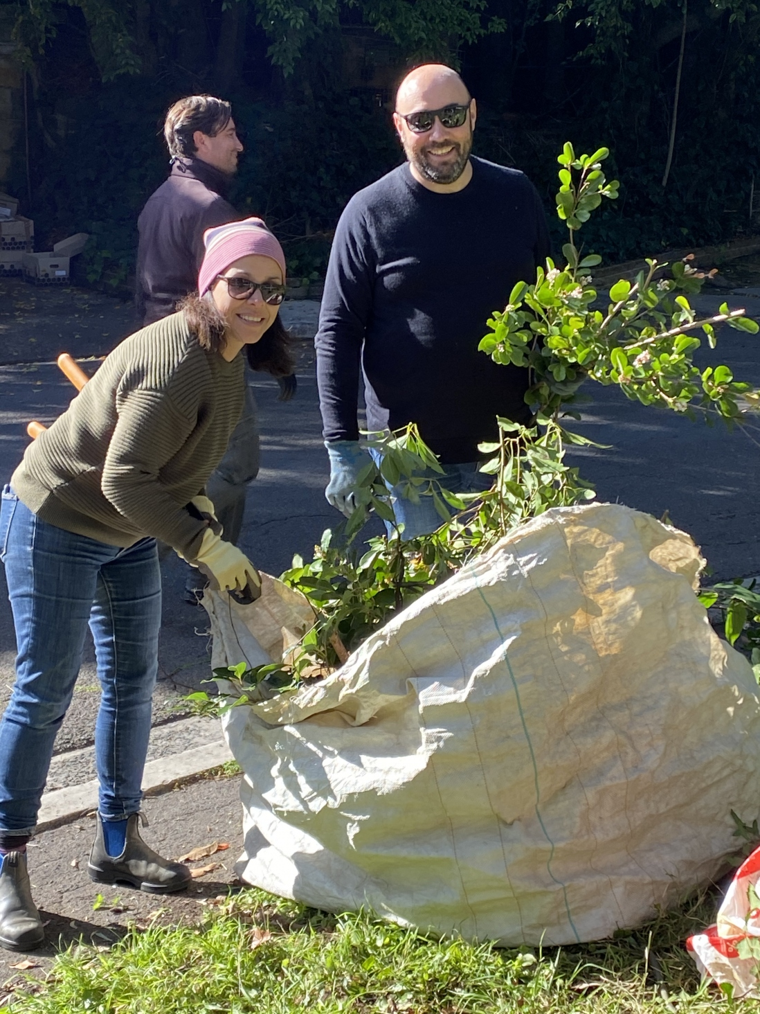 Two SLM staff load up Green waste into a bag for removal at Vaucluse House.