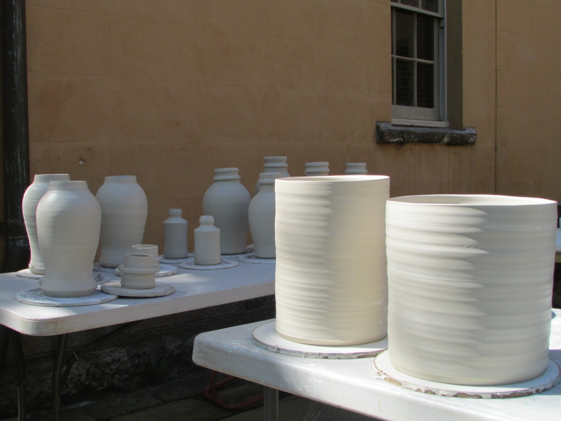 white ceramic vessels drying on tables at vaucluse house