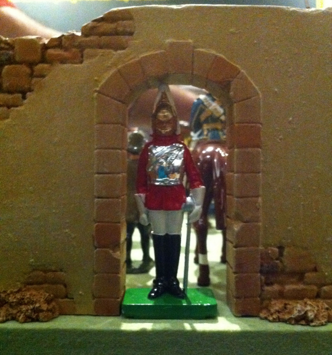 This is a detail photograph of a toy soldier standing in a doorway on guard