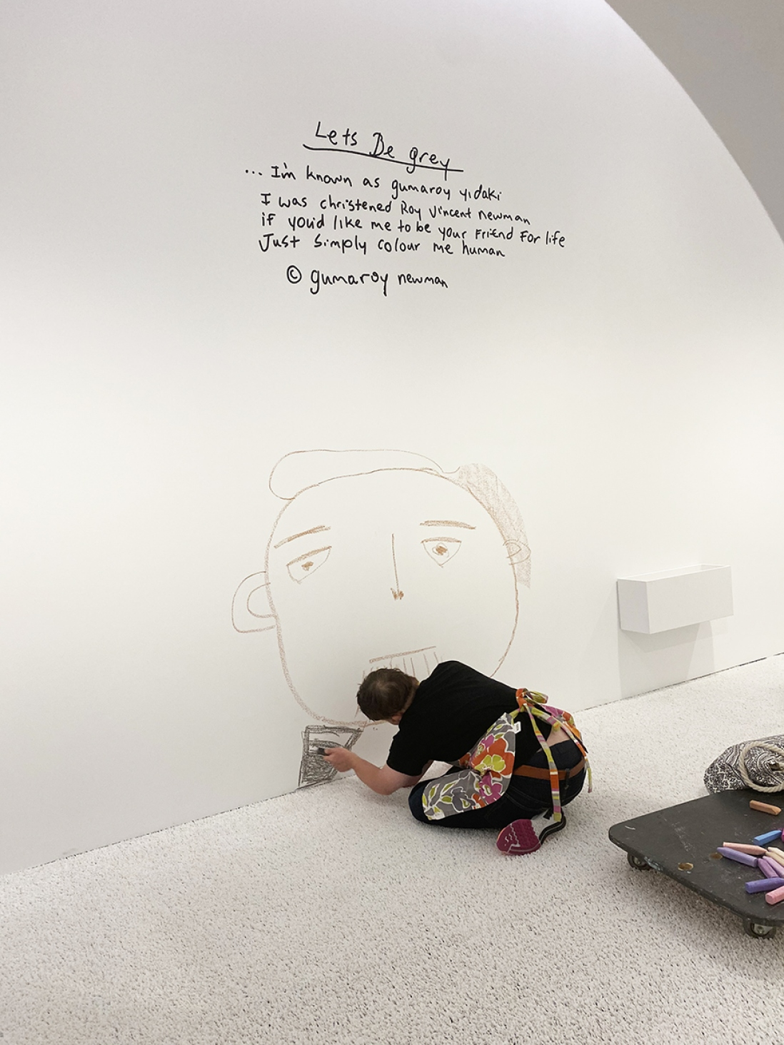 Digby Webster drawing on the wall during Make Your Mark exhibition