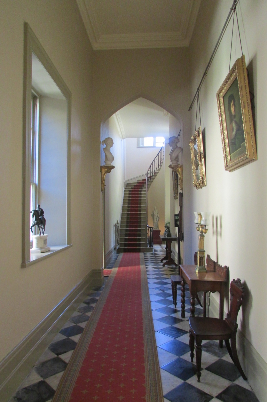Looking down long hall, with furniture and paintings replaced after work completion.