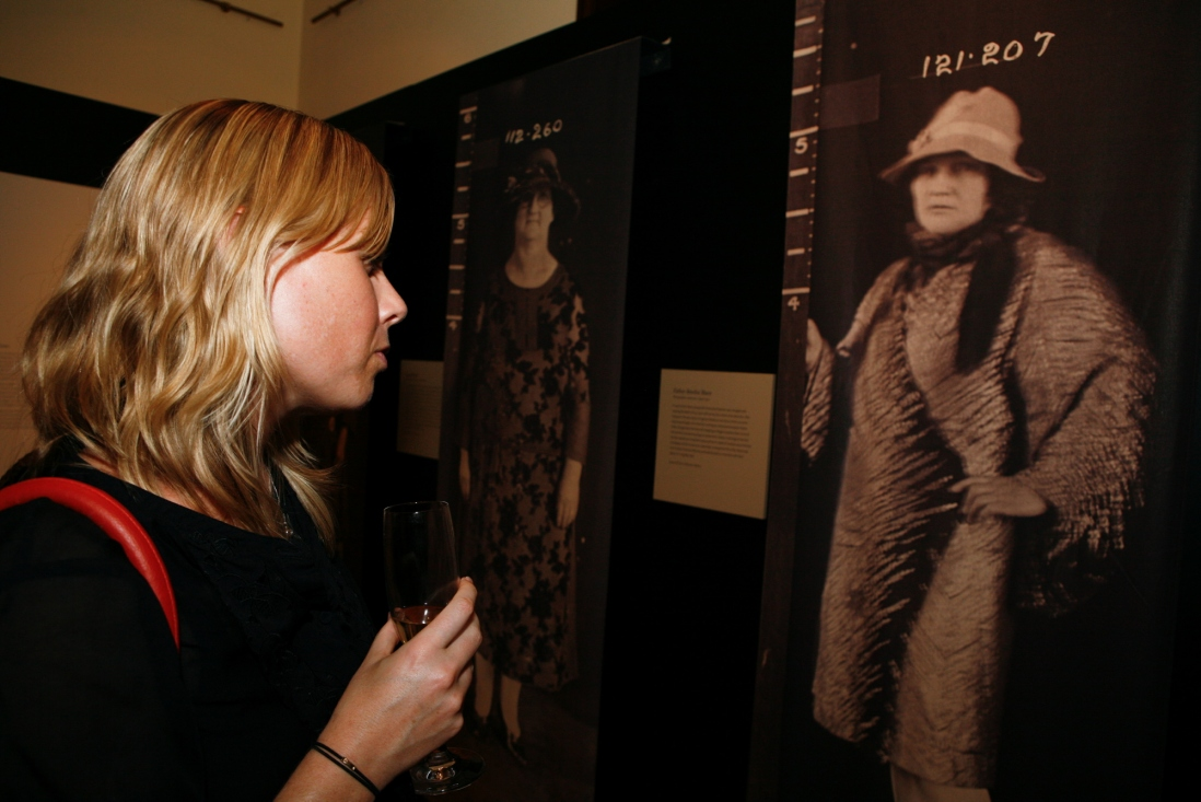 A visitor enjoys the Femme Fatale exhibition at the Justice & Police Museum