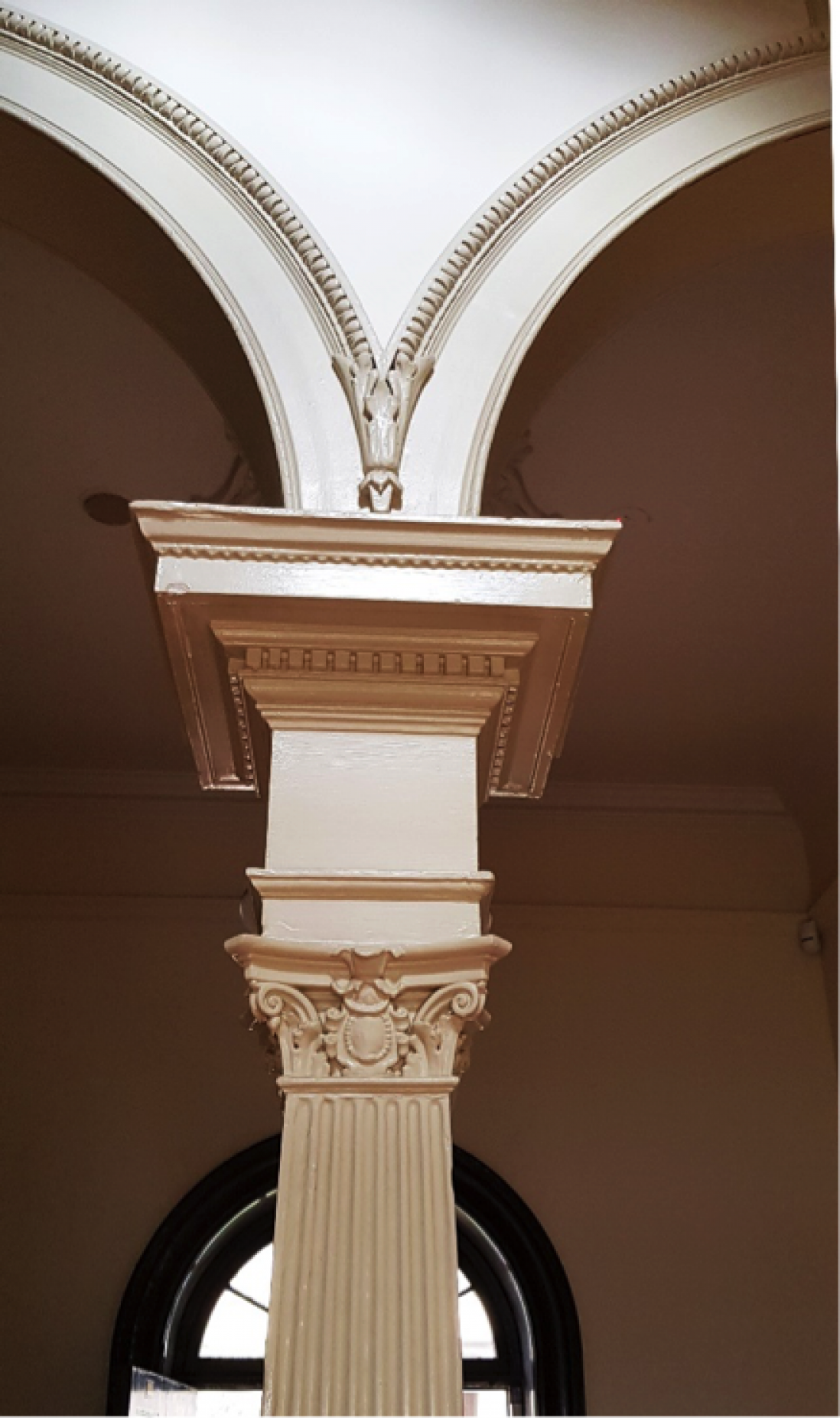 Image of the Corinthian capital supporting the archways at The Mint.