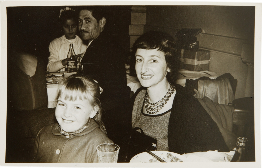 Black and white photo of woman and child in restaurant setting.