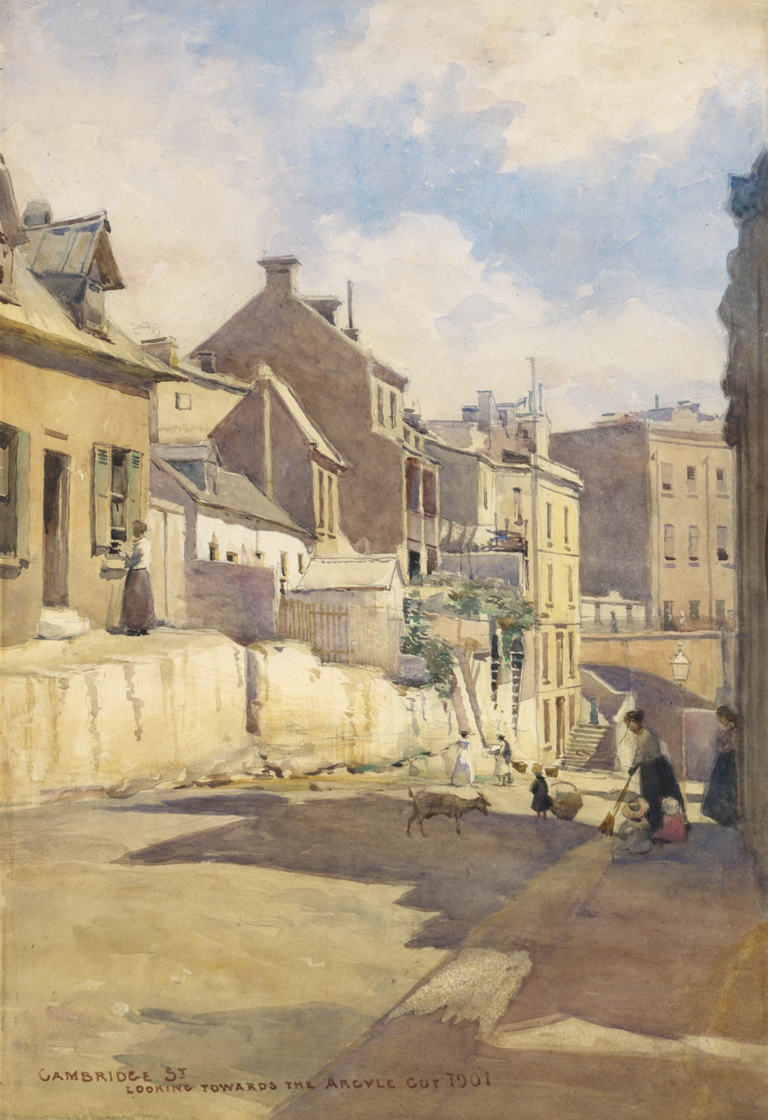 Painting of street scene. A lady, children and a goat gather in a street carved out of the sandstone with a mix of small houses above.