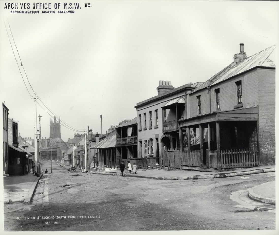 Photograph of street scene showing a row of two storey buildings some with awnings out onto the footpath.