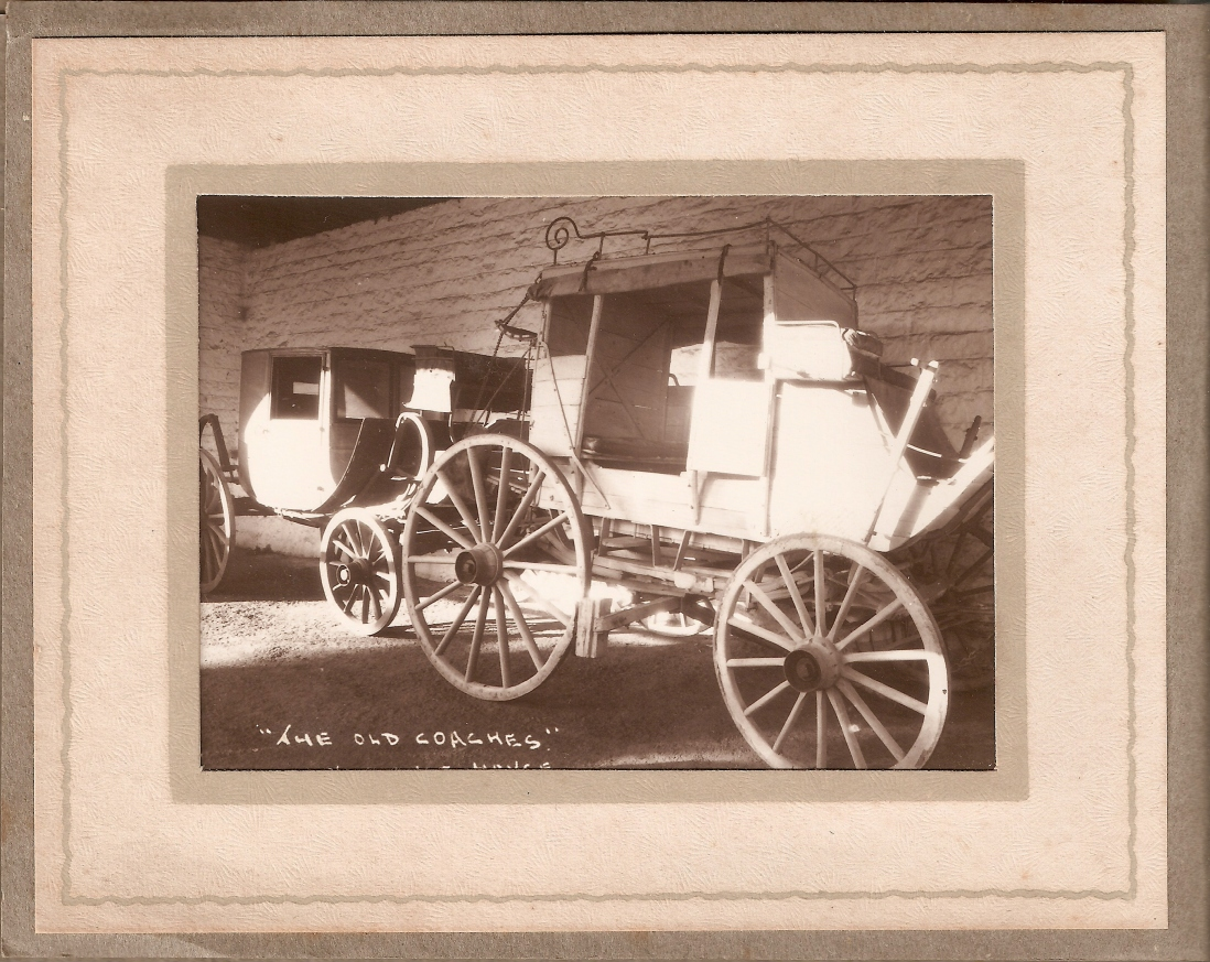 Sepia photo of coaches in frame.