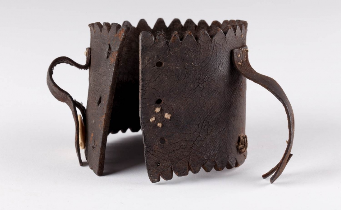 Leather leg iron ankle protector, excavated from beneath the floorboards of Hyde Park Barracks