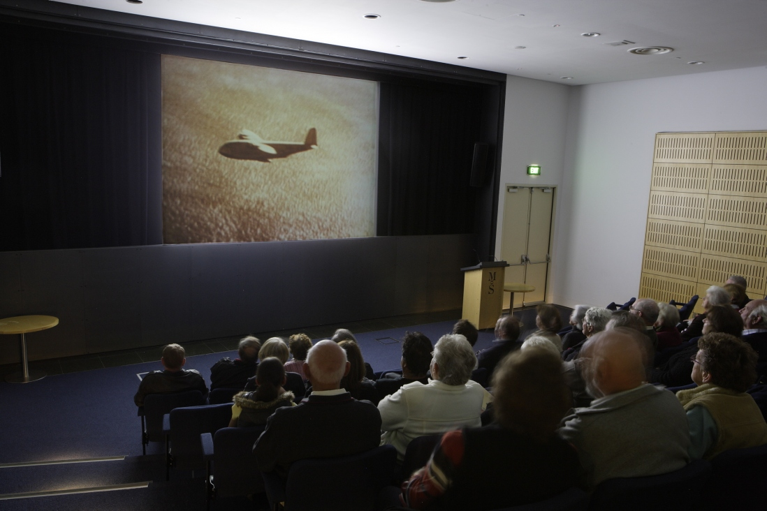 Audience watching 'The ships that flew' in the AGL theatre, Museum of Sydney