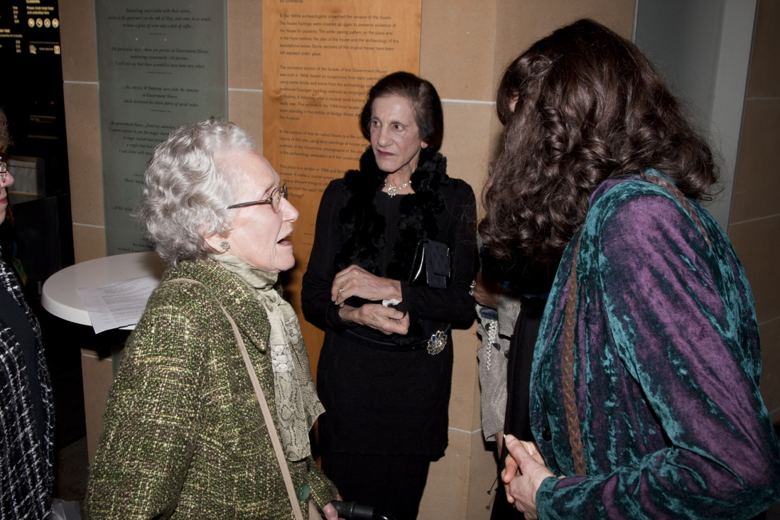 Jeannie Baker speaks with guest during opening