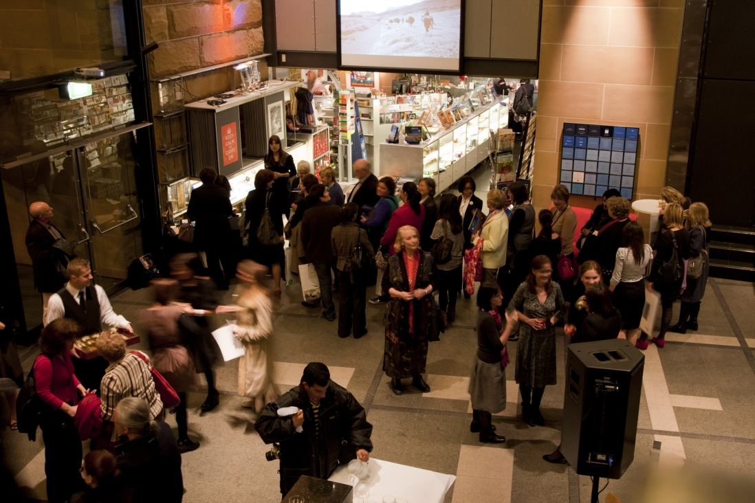 High angle view of Musem of Sydney reception area with guests and MOS Shop