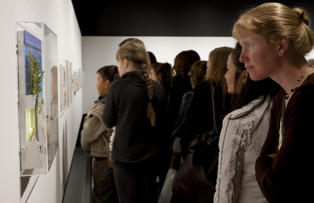 Guests viewing artwork in exhibition space