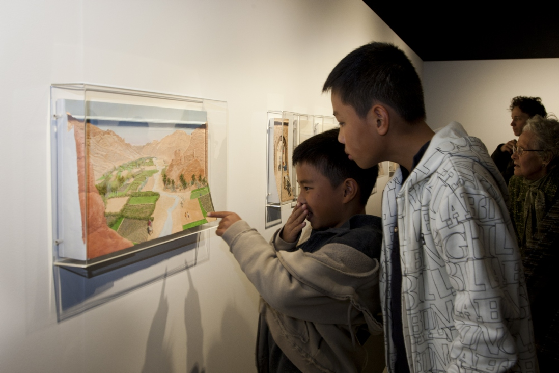 Children looking at artworks in Theme Gallery exhibition space
