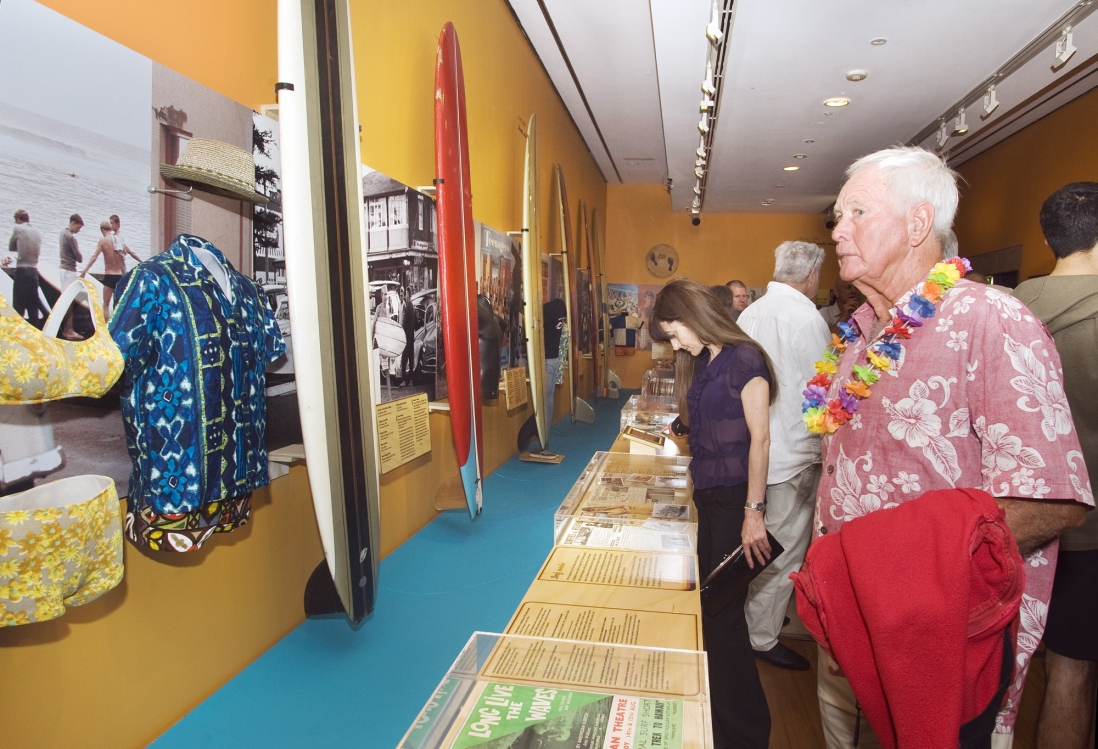 Reading about the history behind the Surf City exhibibition opening