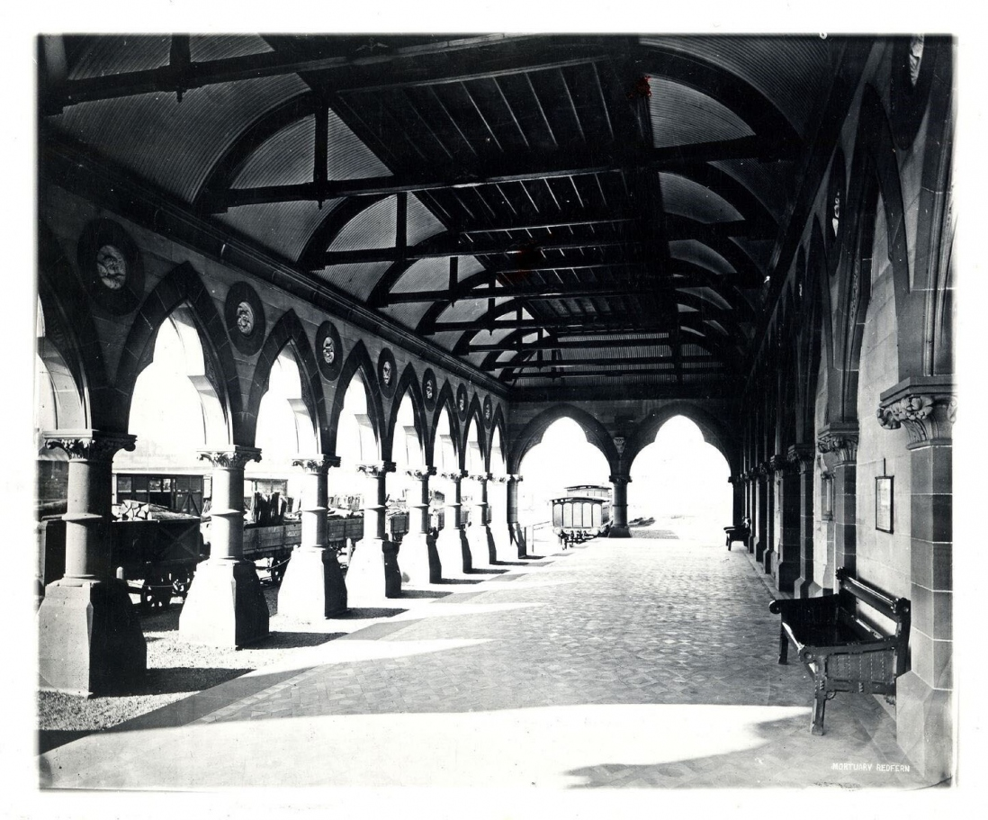 Black and white photo of arched station platform.