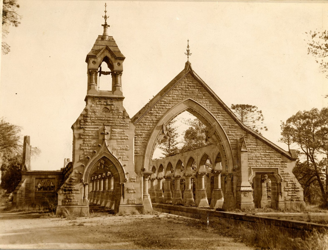 Sandstone building with tower at front.