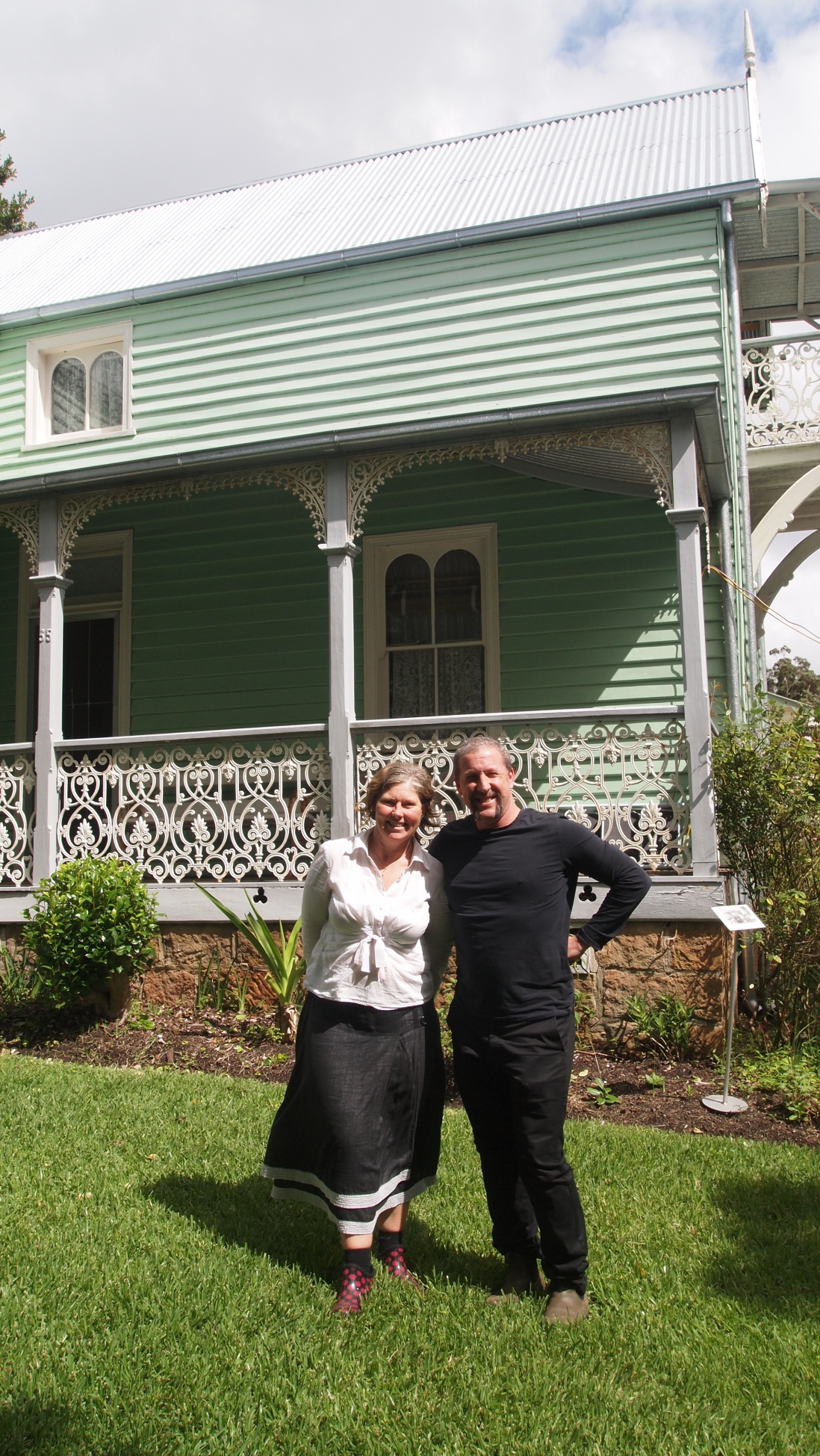 Two people standing outside historic house, Meroogal.